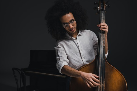 happy young musician playing standup bass 写真素材