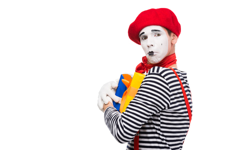 upset mime holding gift boxes isolated on white