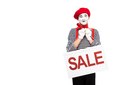 smiling mime holding sale signboard isolated on white