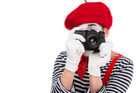 mime taking photo with film camera isolated on white Stock Photo