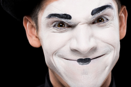 evil mime looking at camera isolated on black Stock Photo
