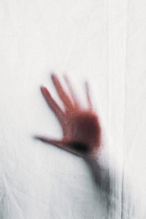 blurry silhouette of human hand touching veil Reklamní fotografie