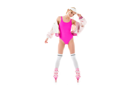Young girl wearing pink swimsuit and roller skates isolated on white Stock Photo