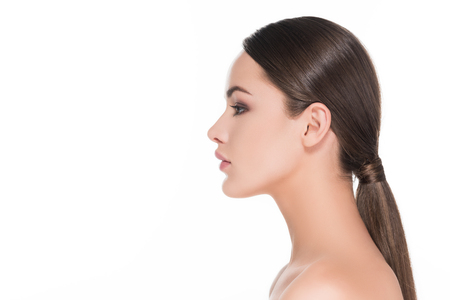 side view of beautiful young woman with pony tail isolated on white 스톡 콘텐츠