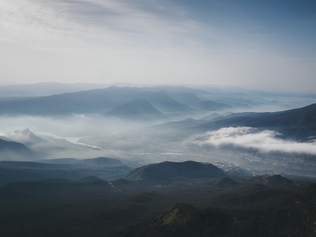scenic view of mountains in fog and sky Stok Fotoğraf
