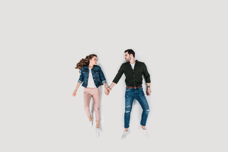 top view of stylish young couple holding hands isolated on white Archivio Fotografico - 111368207
