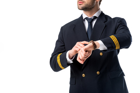 cropped shot of pilot pointing at watch on wrist isolated on white Imagens