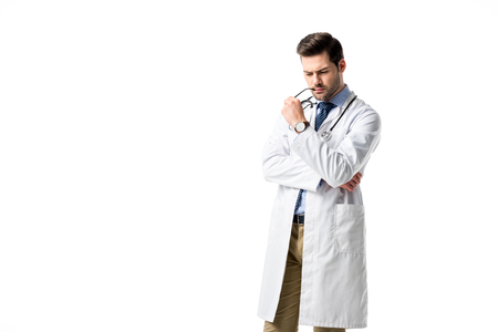 Thoughtful doctor wearing white coat with stethoscope isolated on white Stock fotó