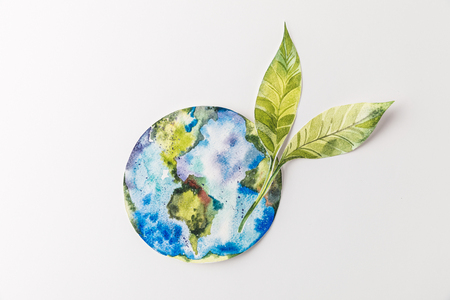top view of handmade colorful paper globe with green leaves isolated on grey, environment protection and recycling concept
