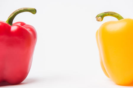 red and yellow bell peppers, on white background