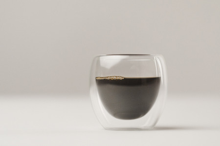 Double Walled Glass cup with coffee on white background