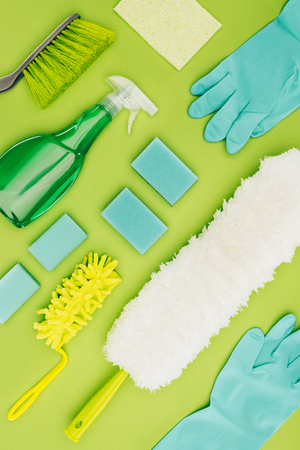 top view of cleaning supplies isolated on light green 写真素材