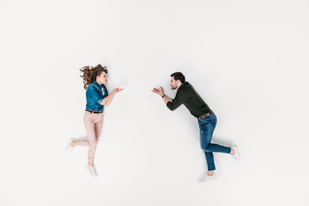 top view of woman throwing blown kiss to boyfriend isolated on white