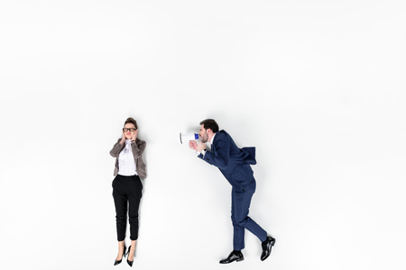 top view of boss shouting at manager with loudspeaker isolated on white