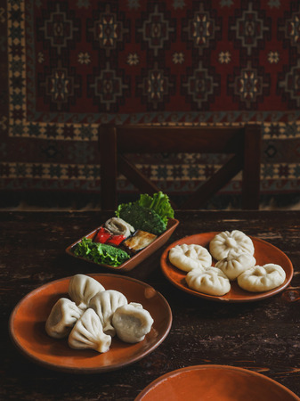 close up view of traditional georgian khinkali on plates Stock Photo