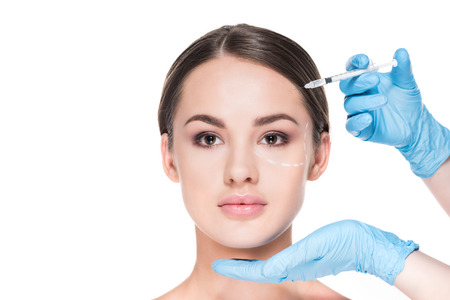 cropped shot of doctor making beauty injection for woman isolated on white Stock Photo