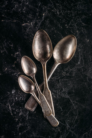 Set of vintage spoons on dark table Stock fotó