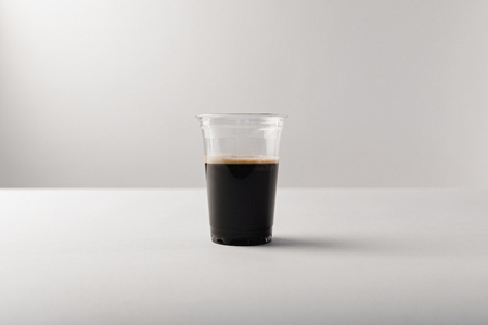 Plastic cup with black coffee on white background Stok Fotoğraf - 111571441