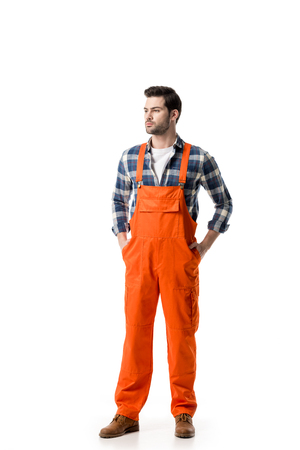 Young confident repairman in orange overall isolated on white