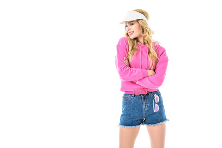 Pretty blonde woman dressed in pink isolated on white Stockfoto