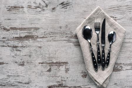 Set of dinner silverware with napkin on wooden table Zdjęcie Seryjne