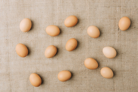 brown eggs scatterd on sackcloth