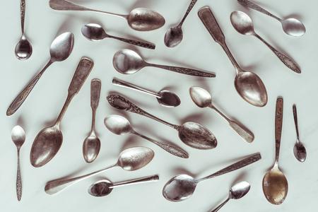 Vintage metal spoons on white background Stock fotó