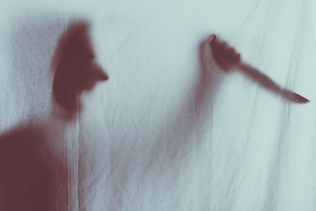 scary blurry silhouette of person screaming and holding knife behind veil Stok Fotoğraf