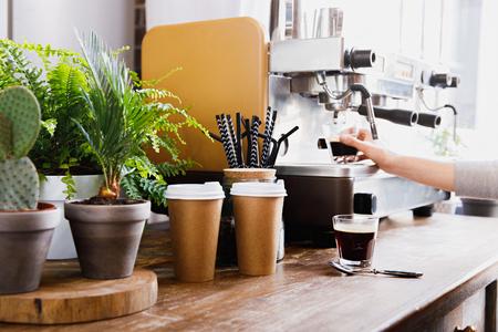 Close-up view of bartender preparing coffee on modern espresso machine