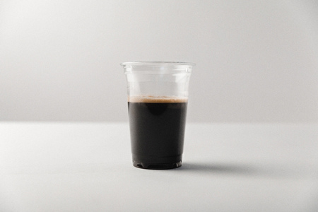 Disposable cup with black coffee on white background Stok Fotoğraf