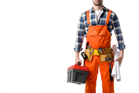 Cropped view of man in orange overall holding tool box and blueprint isolated on white Stock Photo