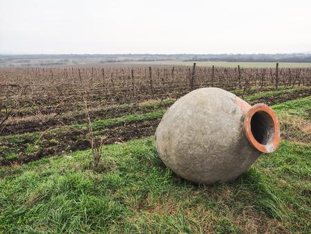 big old clay jug at vineyard in Georgia
