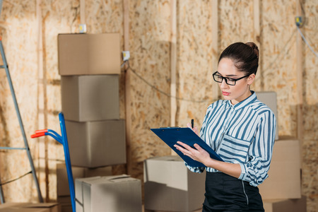 Young businesswoman inspecting delivery documents Stock Photo