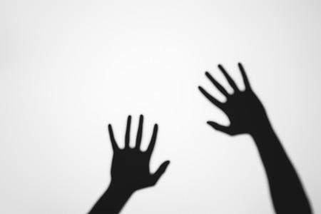 spooky mysterious shadows of human hands on grey Reklamní fotografie