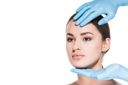 doctor touching face of woman with dotted line for plastic surgery isolated on white Stock Photo