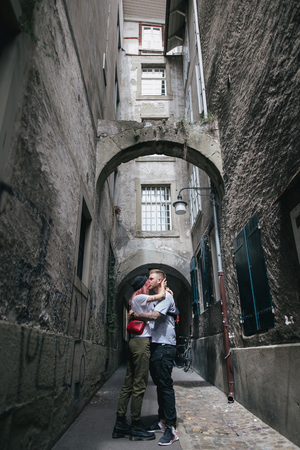 young couple in love kissing on cozy narrow street in Bern, Switzerland 版權商用圖片