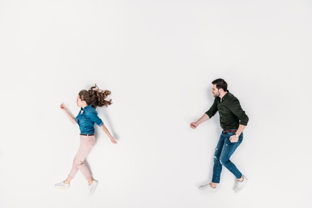 top view of man and woman pretending to walk isolated on white Archivio Fotografico - 111578814
