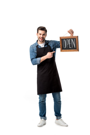 smiling waiter pointing at open blackboard in hand isolated on white Imagens