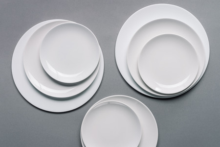 Composition of white plates on grey background Zdjęcie Seryjne