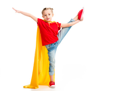 Little supergirl standing on split and gesturing by hand isolated on white