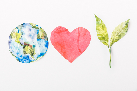 top view of paper made colorful globe, red heart and green plant isolated on grey, recycling and  environment protection concept Stock Photo