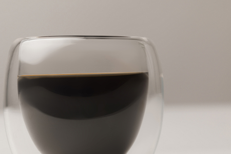 Close-up view of black coffee in cup on white background