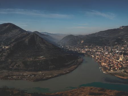 scenic view of river, mountains and beautiful city in Georgia