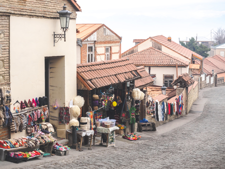 outdoor market with carpets and traditional souvenirs on street in Mestia, Georgia Фото со стока