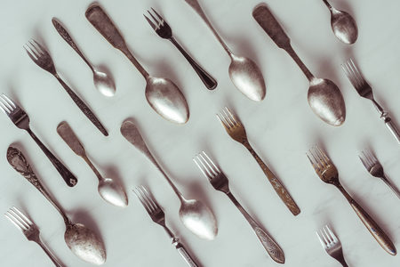Vintage spoons and forks on white table Reklamní fotografie - 111595020