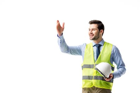 Architect in reflective vest holding hardhat isolated on white