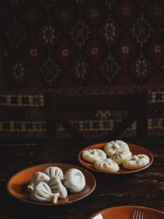 close up view of traditional georgian khinkali on plates 写真素材