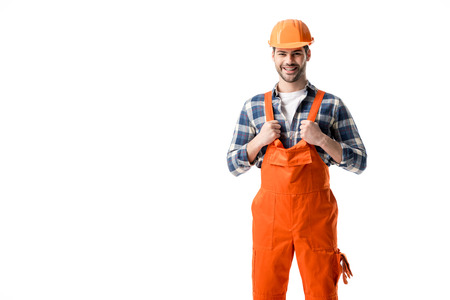 Smiling repairman in orange overall and hard hat isolated on white 写真素材