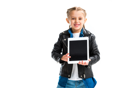 Excited little child with pigtails holding digital device on hands isolated on white Stock fotó