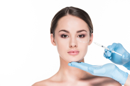 cropped shot of doctor making beauty injection for attractive woman isolated on white